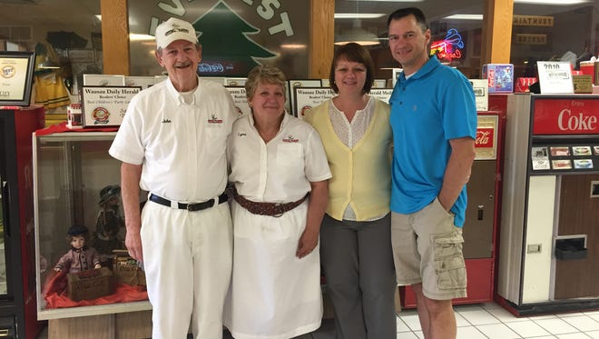 John and Lynn Huber (left) stand with their daughter, Jodi Lacalamita and son-in-law, Vince Calamita, who will take over Sam's Pizza in July.