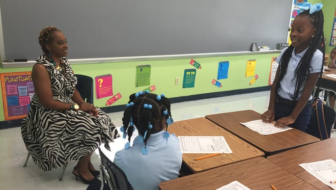 Third-grade teacher Cleoria Dunn uses a memory game to help students remember each other's names Friday at Barkdull Faulk Elementary.