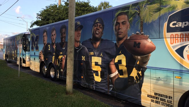 An Orange Bowl bus waiting for the Michigan Wolverines' football team Dec. 25, 2016 in Miami, Fla.