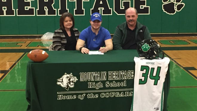 Mountain Heritage senior Adam Shuford has signed to play college football for Mars Hill.