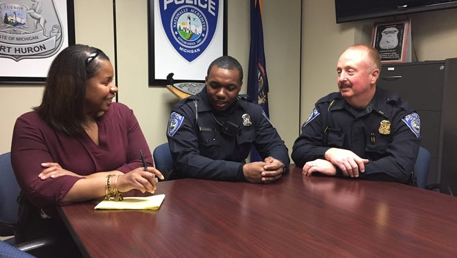 Officer Jamie Brown, center, meets with Detective Karen Brisby and Lt. Joseph Platzer at the Port Huron Police Department. Wednesday was Brown's first day on the job.