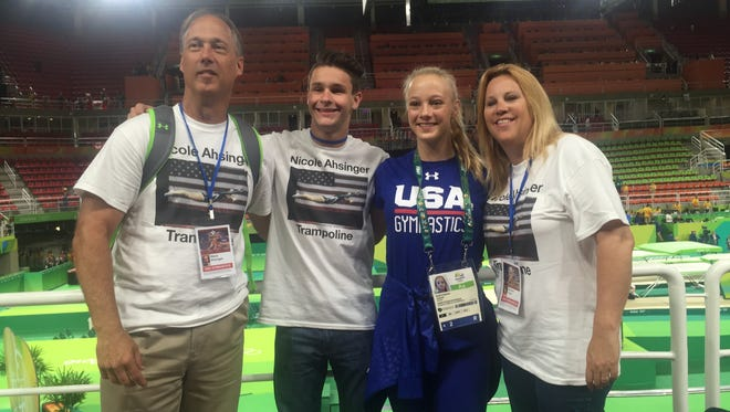 Nicole Ahsinger poses with her dad, Steve Ahsinger (left), friend and teammate Alexi Shostak (second from left) and mom, Michelle Taylor (right) at the 2016 Summer Olympics in Rio.