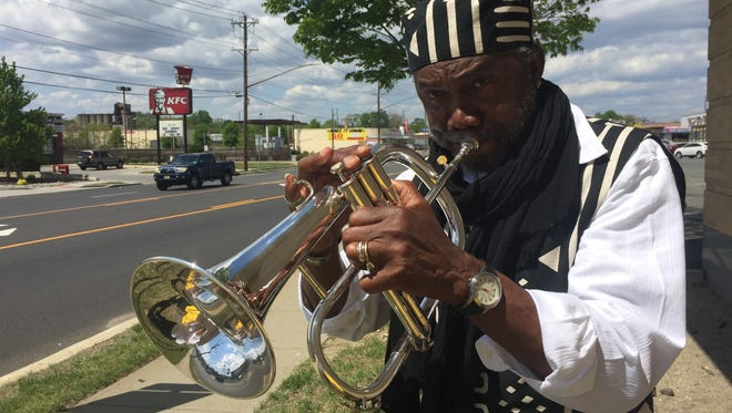 John Berry, 75, of Vineland, plays to traffic along Delsea Drive in Vineland, hoping to inspire them to think of Jesus.