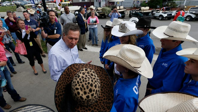 Ohio Gov. John Kasich talks with members of the Ohio junior high rodeo team Wednesday.
