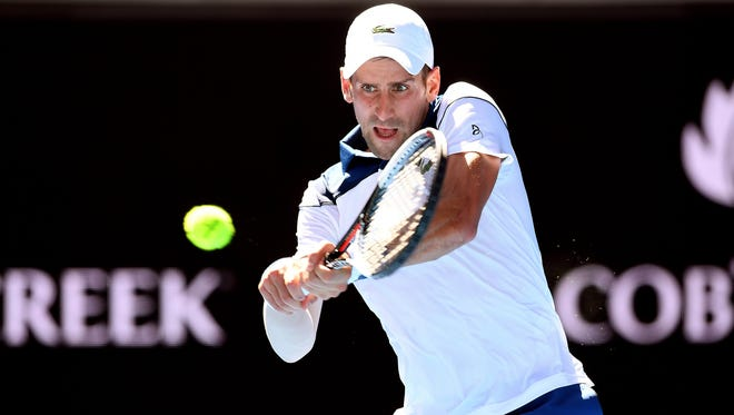 Novak Djokovic in action against Donald Young during round one of the Australian Open tennis tournament.