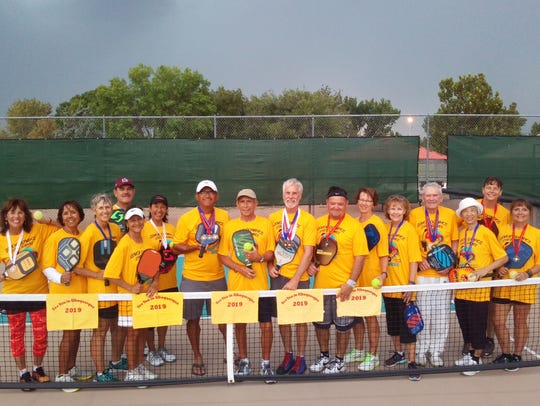 Pictured are 16 of the 22 Las Cruces pickleball participants