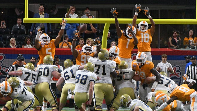 The Tennessee line leaps to block an extra point by Georgia Tech in overtime at the Chick-fil-A Kickoff Game Monday, Sep. 4, 2017 against Georgia Tech in Atlanta, Ga.