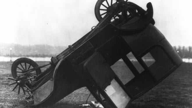 """""""Car turns turtle, injuring 3"""" read the headline after this 1922 accident. Drivers often didn't understand that taking corners at high speed would have dire consequences."""