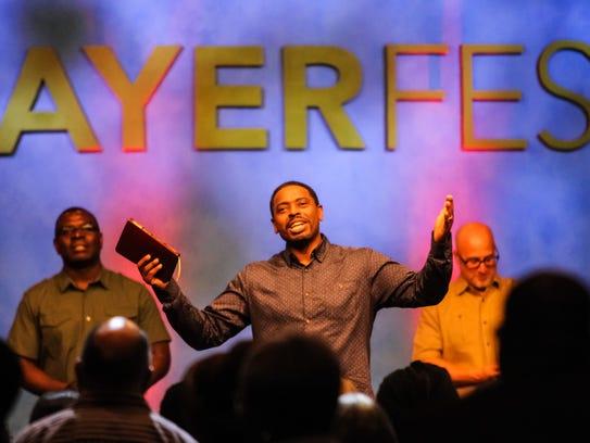 Pastor David Ireland talks to the crowd during Prayerfest