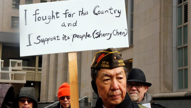 Lee Wong of West Chester demonstrates outside the federal courthouse in Downtown Tuesday as the court hears Sherry Chen's arguments in her wrongful termination and discrimination case. Chen was accused of espionage in 2014, the charges were dropped, but she was fired from her job at the National Weather Service in Wilmington.