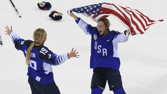 Feb. 22: U.S. players celebrate after defeating Canada in the women's hockey gold medal game in a shootout.