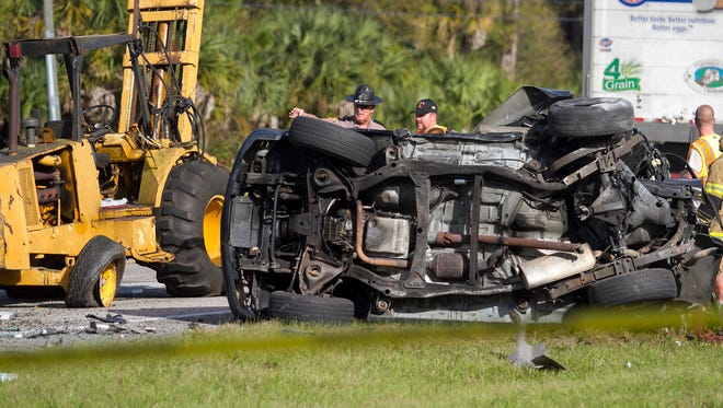 FHP officers investigate a fatal crash on Palm Beach Boulevard east of Bateman Road on Saturday, January 3, 2015.