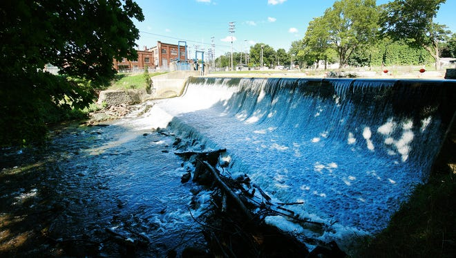 The Marshall dam on South Marshall Avenue. Officials are considering whether to restore or remove the 124-year-old dam, which produces 1 percent of the city's total energy requirements.