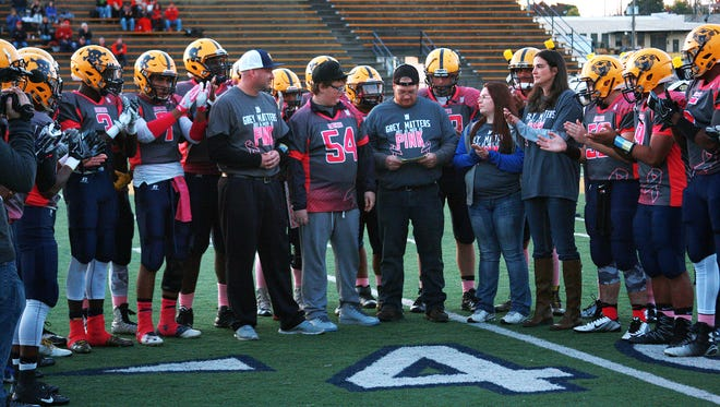 The Battle Creek Central High School football team honored Michael Miller, then a freshman, at a game in 2016.
