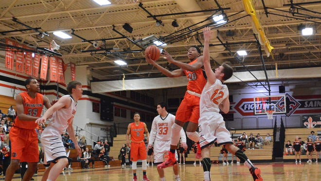 Evanston's Nojel Eastern (20) finger rolls the ball in for two points. Eastern committed to Purdue on Wednesday.