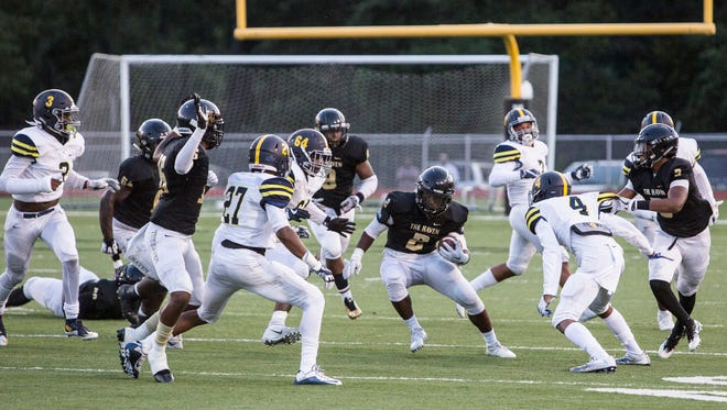 Chris Witherspoon (center) will lead the Whitehaven offense against visiting Germantown Friday in a match-up of teams ranked fifth and fourth respectively in the state 6A poll.
