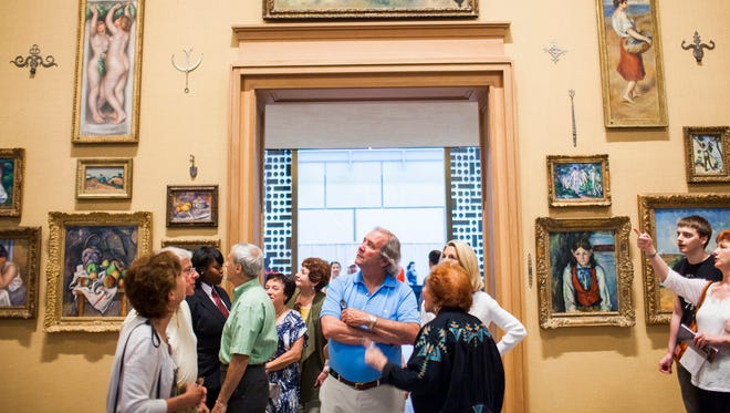 Visitors view art pieces in the main gallery of the Barnes Foundation in Philadelphia. The Barnes is celebrating five years since it moved to its new location in Philadelphia from Merion, Pennsylvania, with special programming planned.