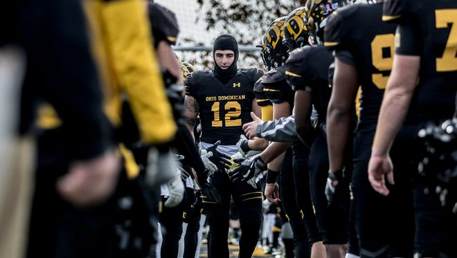 Newark graduate Grant Russell and other Ohio Dominican seniors were honored before the start of the game against Findlay on Saturday.