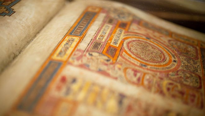 The Book of Kells, a medieval masterpiece on display at Trinity College, was elaborately inked and meticulously illustrated by monks.