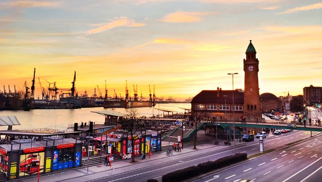 The sun sets over Hamburg's huge port, one of Europe's busiest, which accommodates about 9,000 vessels a year.