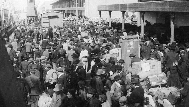 European emigrants crowd a dock in Antwerp, Belgium, before boarding a Red Star Line ship for New York.