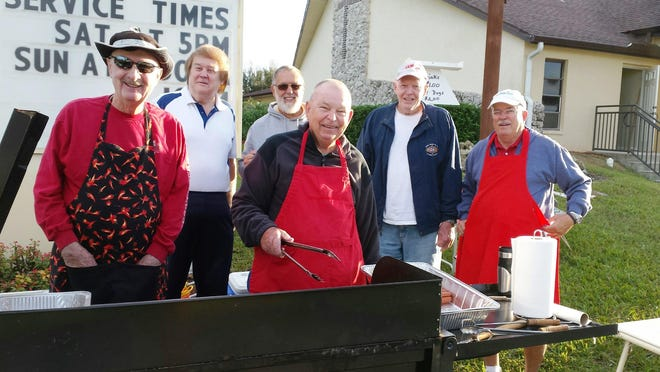 Capri Christian Church grill masters keep annual All-Island Yard Sale shoppers coming back for more of their famous hot dogs.