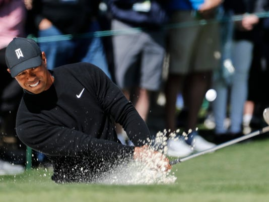 Tiger Woods hits from a bunker on the second hole during the first round at the Masters golf tournament Thursday, April 5, 2018, in Augusta, Ga. (AP Photo/David Goldman)