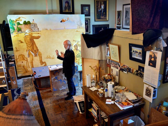 Artist Charles Kapsner talks Monday in his Little Falls studio about the process of creating his painting depicting the U.S. Coast Guard. The work is the third of five large paintings depicting the branches of the American military.