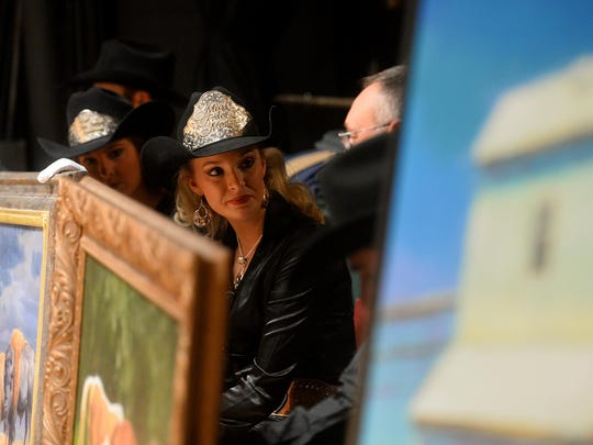 Miss Rodeo Montana Lindsay Garpestad waits to show a piece backstage at 2016's Russell Auction at the Civic Center.