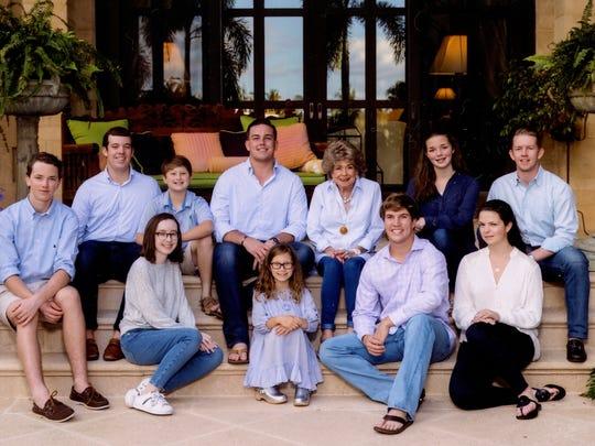 Lucille Drackett, center right, with her 10 grandchildren.