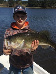 Austin Lawler, 12, fished with Garrett Jackson,17, to catch this nice 7 lb. bass from a private lake.