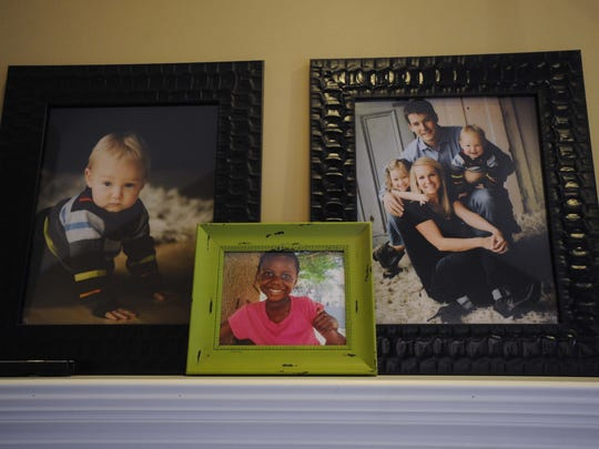 Family photos are on display on a mantle in the Larner home.