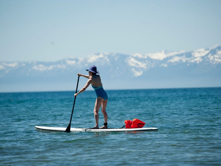 Jean Crouch of Palo Alto, California, navigates a paddleboard in Lake Tahoe during the summer of 2011.