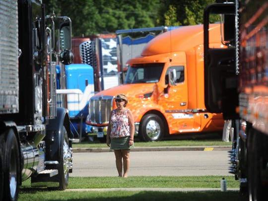 A spectator views a truck at the 25th Annual Waupun Truck-n-Show. Truckers from around the country gather to show off their rigs in a salute to the trucking industry.