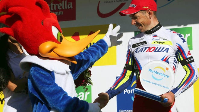 Russian rider Sergey Chernetskiy of Team Katusha celebrates on the podium after winning the sixth stage of the Volta a Catalunya.