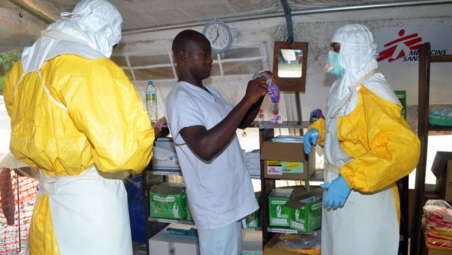Members of Doctors Without Borders fight Ebola in Guinea in July 2014.