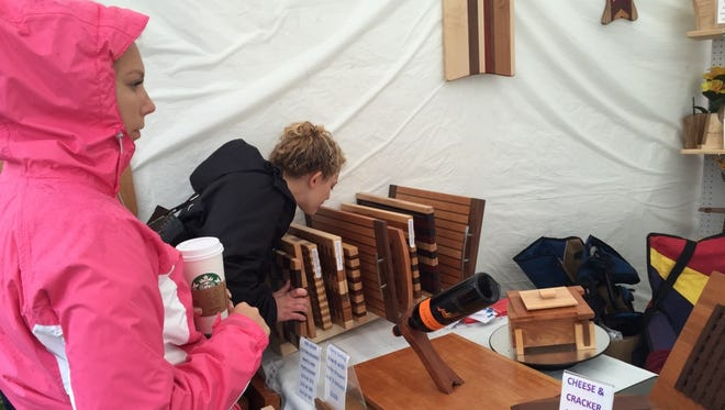 Madeline and Jackie, cousins and members of the Tondrowski family, look at custom cutting boards during their annual trip to Clothesline.
