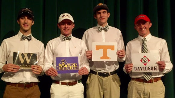 Christ School golfers Chris Akers, second from left, and Michael Freeman signed to play college golf in November. They are pictured here with Greenies soccer player Young Perry and basketball player John Fulkerson.