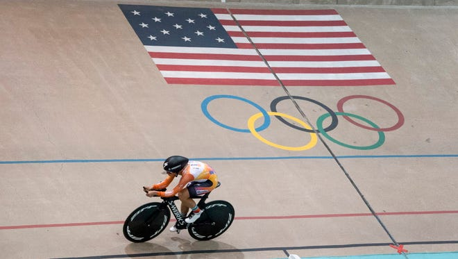 Evelyn Stevens races around the Olympic Training Center Velodrome on her way to breaking the the women's cycling hour record, Saturday, Feb. 27, 2016, in Colorado Springs, Colo. The 2012 Olympian set the new record of riding 29.81 miles (47.98 kilometers) in one hour.