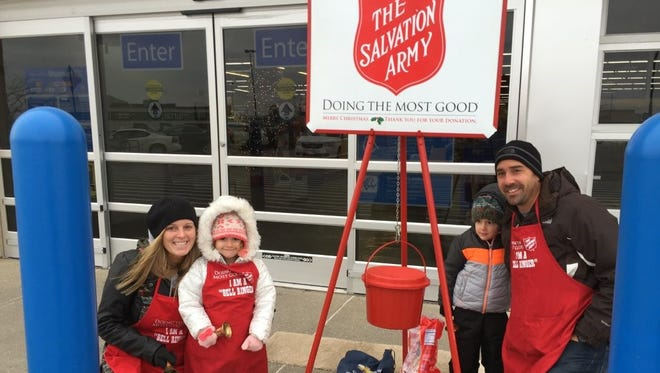Gavin and Lisha Marsh are with Hadley and Charlie as they volunteer to be bell ringers for The Salvation Army in 2016.