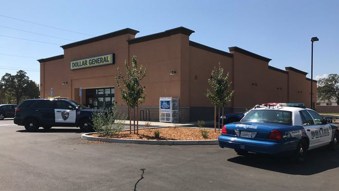 Redding police respond to reports of an armed robbery at the Dollar General on Lake Boulevard on Friday.