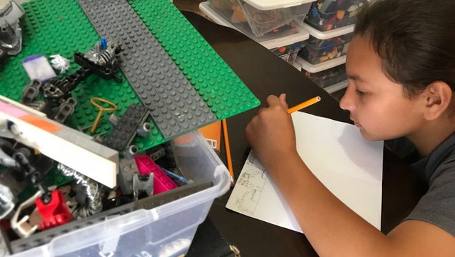 "Sage Dela Cruz works on the stop motion film ""Brain Child."""
