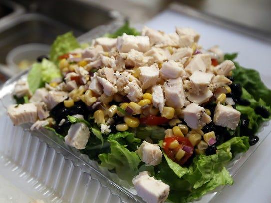 A custom salad awaits the final toppings at Greens