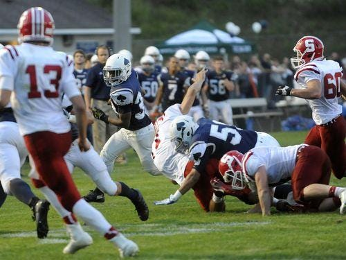 Granville freshman Brandon Haley breaks out of the pack during the opening win against Sheridan.