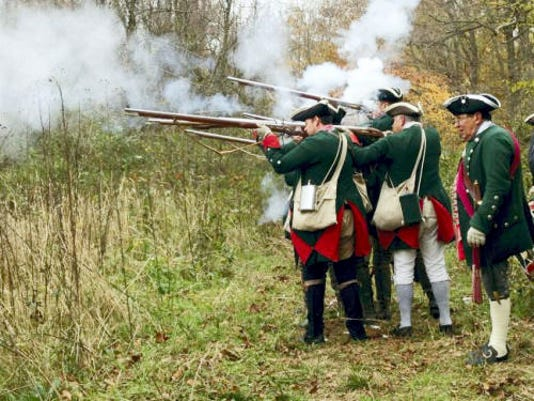 A group of Black Boys Rebellion re-enactors fire their muskets last November in Fort Loudon as part of a living-history lesson on colonial life and early armed resistance to British rule.