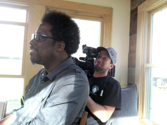 """W. Kamau Bell, host of a new CNN documentary series entitled """"United Shades of America,"""" prepares to interview Natalie Pollard for the series on Tuesday. The crew was filming in Asheville recently."""