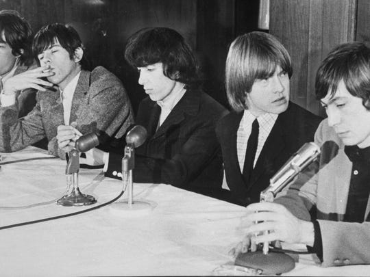 The Rolling Stones look distracted at a news conference