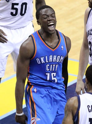 Reggie Jackson (15) poured in a game-high 32 points off the bench for the Thunder.