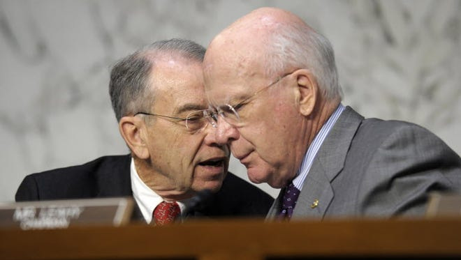 Senate Judiciary Chairman Sen. Patrick Leahy, D-Vt., right, talks with the committee's ranking member, Sen. Charles Grassley, R-Iowa, on Capitol Hill.