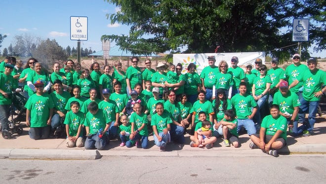 Comcast employees in Deming and their families spent early Saturday planting flowers and cleaning the Voiers Park area in preparation for the 11th annual Celebration of Life Cancer Walk to be held on Saturday, May 7. The event was part of Comcast Cares Day on a national scale.